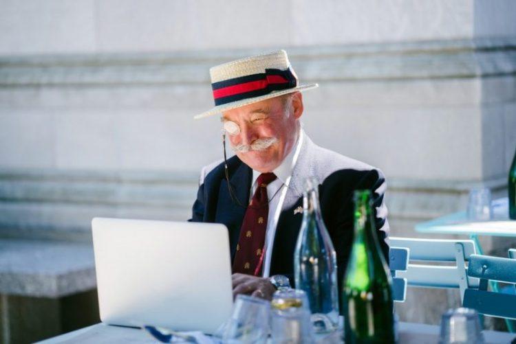 elderly man on a laptop